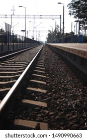 Train track going of into the distance leading lines