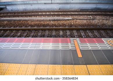 Train track railroad and waiting path, horizontal view
