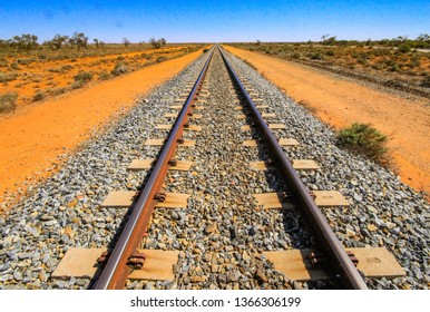 Train tracks of the Adelaide Broken Hill line, in the red sands of the Australian outback.