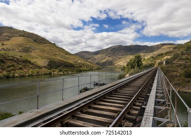 Train tracks along the Douro River in the wine region of the Douro Valley in Portugal; Concept for travel in Portugal and in the Douro Region