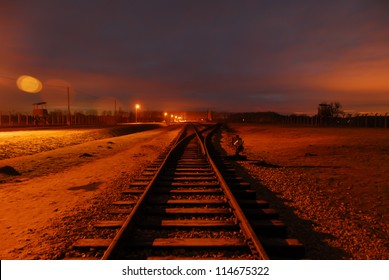 Train tracks at Birkenau Concentration Camp at night.