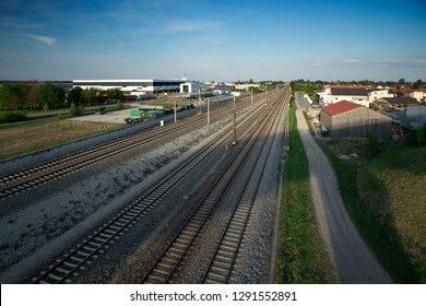 Train tracks in a countryside with industry at Maisach in Bavaria, Germany