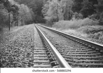 Train tracks in The Gorge. Perspective looking down train tracks in the Columbia River Gorge in southern Washington USA. Black and white photo.