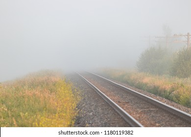 Train Tracks Leading Off Into Solid Fog