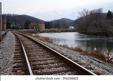 Train tracks run along the river and through a small town in West Virginia's coal country
