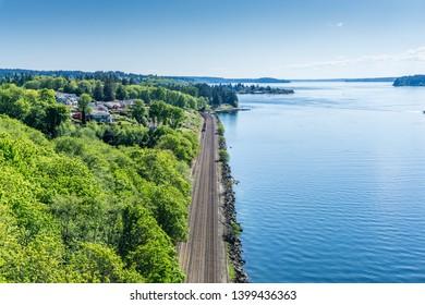 Train tracks run along the shore  of the Tacoma Narrows waterway.