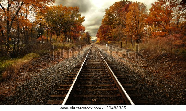 Train tracks running through trees in fall color/Steel Rails Fall
