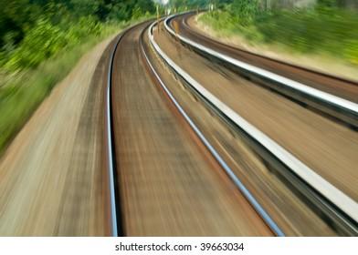 train tracks speed blur curve