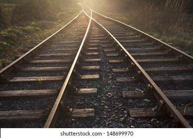 train tracks at sunset