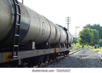 The train transports oil in tanks .