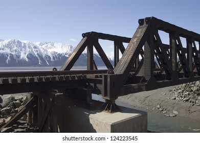 Train Trestle and Alaskan Mountain Range