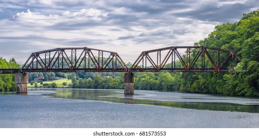 Train trestle bridge over lake