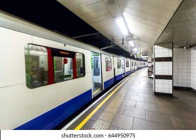 Train in underground station, London.