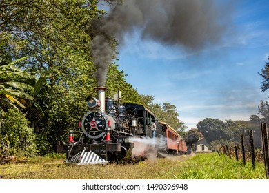 Train waiting for passengers - steam locomotive in Minas Gerais, train ride between the cities of Tiradentes and Sao Joao del Rey in Minas Gerais Brazil
