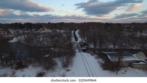 Train winding through small town aerial view
