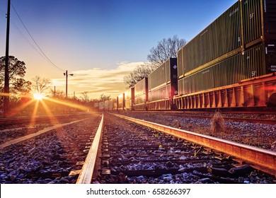 Train yard at sunset