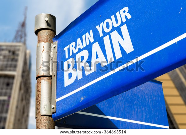 Train Your Brain written on road sign