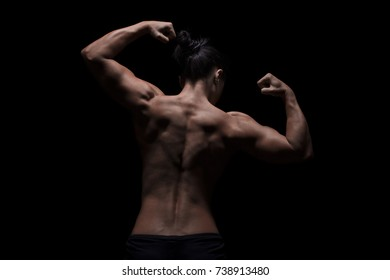trained arms shoulders and back of a woman, low-key