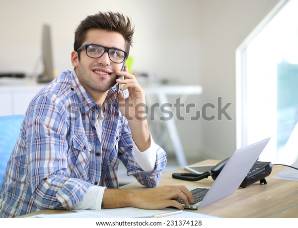 Trainee in office talking on the phone