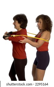 trainer and client exercising with stretch bands at the gym