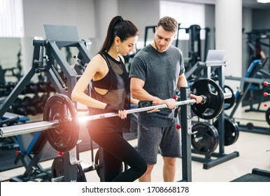 Trainer and client at the gym with sports equipment. Young and fit. nice body, athletic form. Healthy fitness life concept.