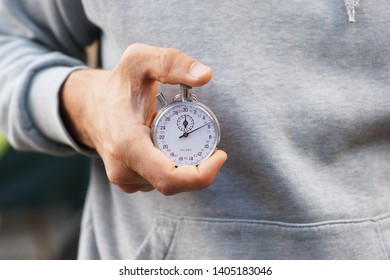 Trainer holding stopwatch - close up