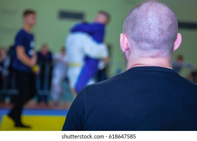 the trainer looks at ju-jitsu competitions