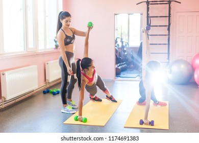 Trainer showing how to do the exercise