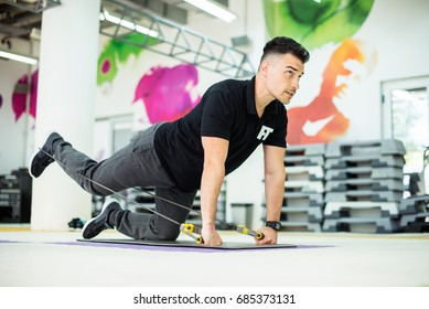Trainer is showing how to do exercise properly