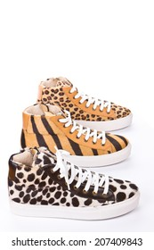Trainers with wild cat pattern on white