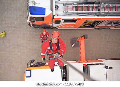 training in altitude rescue at the fire brigade - emergency operation with a crane trolley and abseiling