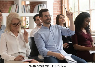 Training audience participants raise hands up ask question at conference workshop meeting sit on chairs, business people group voting participate corporate lecture conference seminar presentation