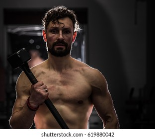 training cross fit in the gym,muscular man is at the gym,the concept of sport