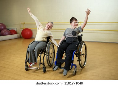 Training for dance competition of inclusive dance of handicapped children on wheelhairs with trainers in sport hall in Estonia, optimism and desire to act
