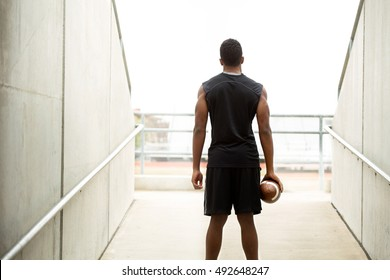 Training Day.  American football athlete heading out on the field for training.