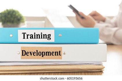 Training and Development document on desk in meeting room.