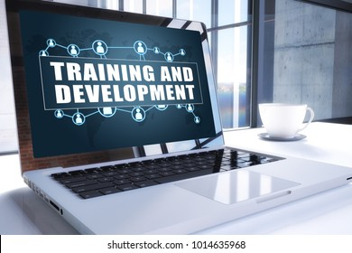 Training and Development text on modern laptop screen in office environment. 3D render illustration business text concept.