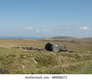 Training Exercise by the British Army on Okehampton Range with Belstone Tor in the Background within Dartmoor National Park in Devon, England, UK