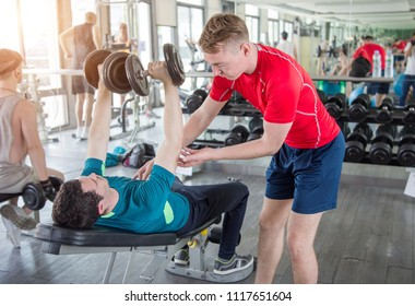 training fitness coaching at gym with dumbbell for healthy. trainner  sport activities concept.