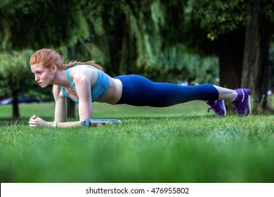 Training fitness woman doing plank core exercise working out for back spine and posture outdoors in park. Fitness Photoshoot with model Grace Gray. Photo by Phil Jones Photography.