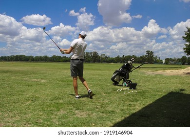 Training golf shots while driving.