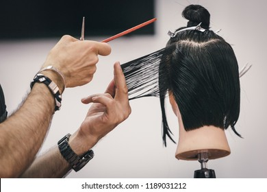 Training hairdresser with mannequins