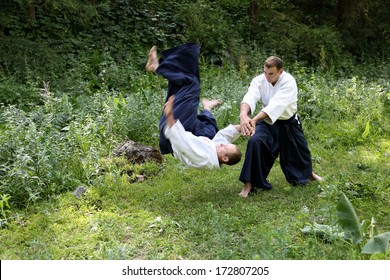 Training  martial art  Aikido. On nature. outdoors. Summer day