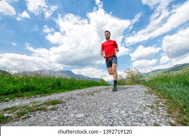 Training of a mountain marathon runner on country road