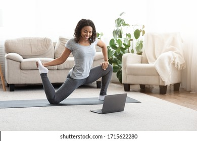 Training On Isolation. Sporty Young Woman Practicing Yoga In Front Of Laptop, Watching Online Tutorials