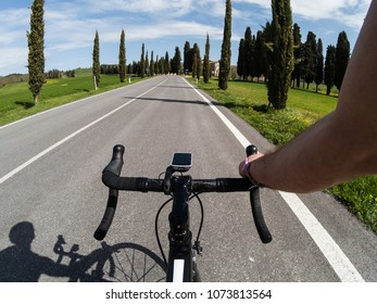 Training on a racing bicycle. Young adult athlete riding a bicycle in Tuscany on spring season