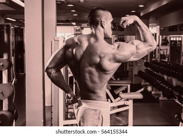 Training process men at the gym