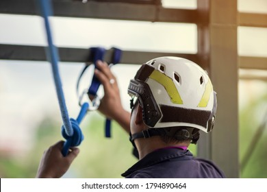 Training rescue emergency accident, Man wearing helmet accessories for training high building rescue using ropes.