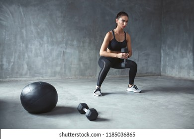 Training. Sports Woman In Fashion Sportswear Doing Squats