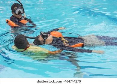 TRAINING VICTiM DROWNING C-SPINE INJURY  AUGUST 5,2016 BANGKOK,THAILAND : Training victim drowning case problem c-spine injury at pool NAVY HOSPITAL AUGUST 5,2016 BANGKOK, THAILAND
